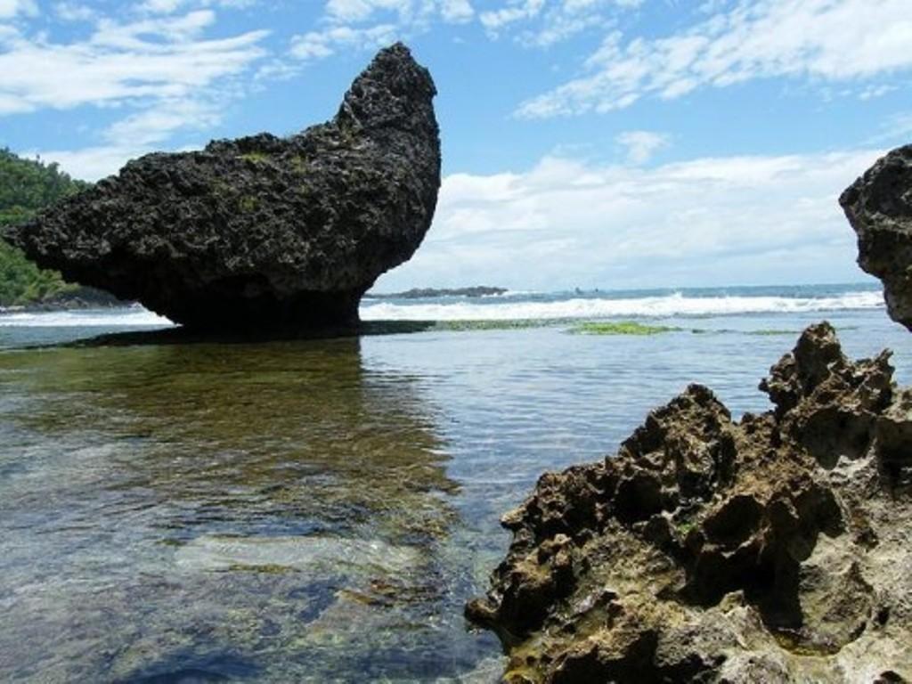 Buletin Wisata Pantai Siung Gunung Kidul Yogyakarta