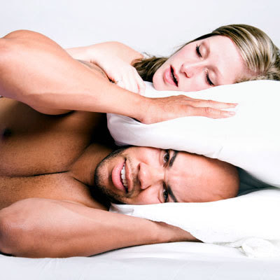 woman snoring and man irritated