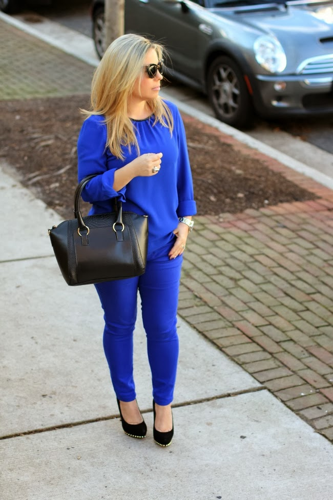 blue monochromatic look of the day and black bag