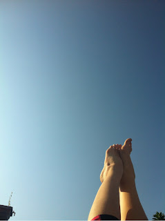 legs up in the air. clear blue sky