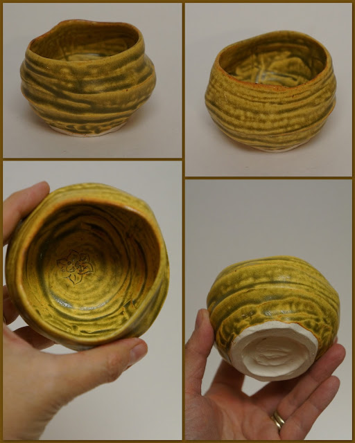 Ceramic pottery wabi-sabi guinomi or tea cup finished in ash yellow glaze.