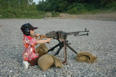 little girl and real machine gun