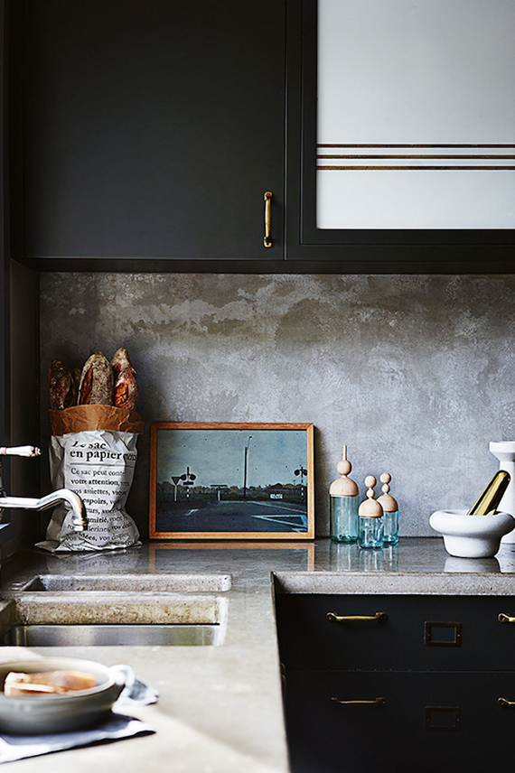 Kitchen with concrete countertop and splashback. Photo  by Anson Smart, styling by Claire Delmar for Inside Out Magazine