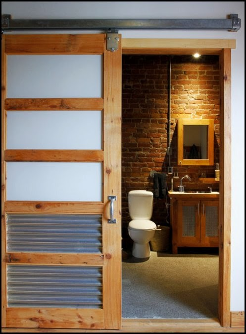 sliding barn door on bathroom content in a cottage