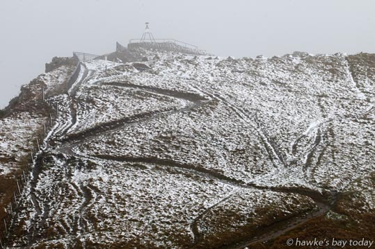 The trig station in light snow at the top of Te Mata Peak, Havelock North. photograph