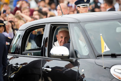 Pope Francis smiles as he leaves the airfield at Joint Base Andrews in a Fiat Sept. 22 outside Washington. (CNS photo/Jaclyn Lippelmann, Catholic Standard) See POPE-US-ARRIVE Sept. 22, 2015.