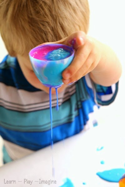 Drip painting creations with plastic Easter eggs