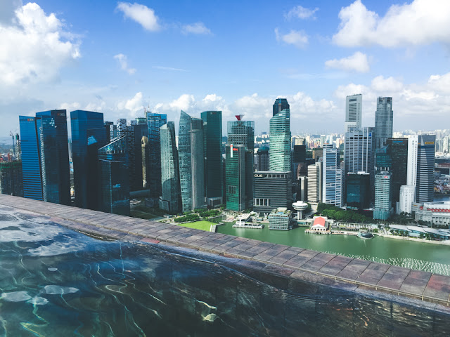 there's a lot of reasons to stay at the luxurious Marina Bay Sands in Singapore, but the infinity pool that overlooks the skyline is probably at the top of the list!