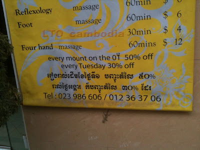 Cambodia: Sign for massage and discount mount