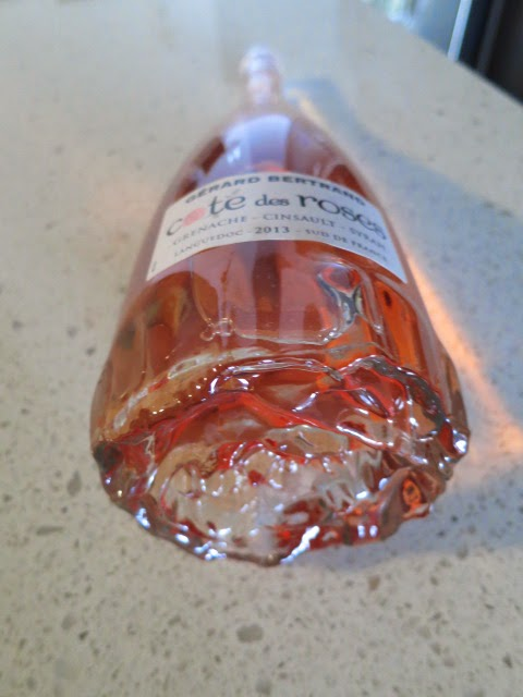 Rose design on bottom of bottle