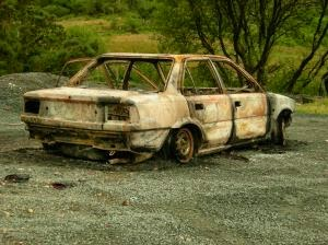image of a beat up car