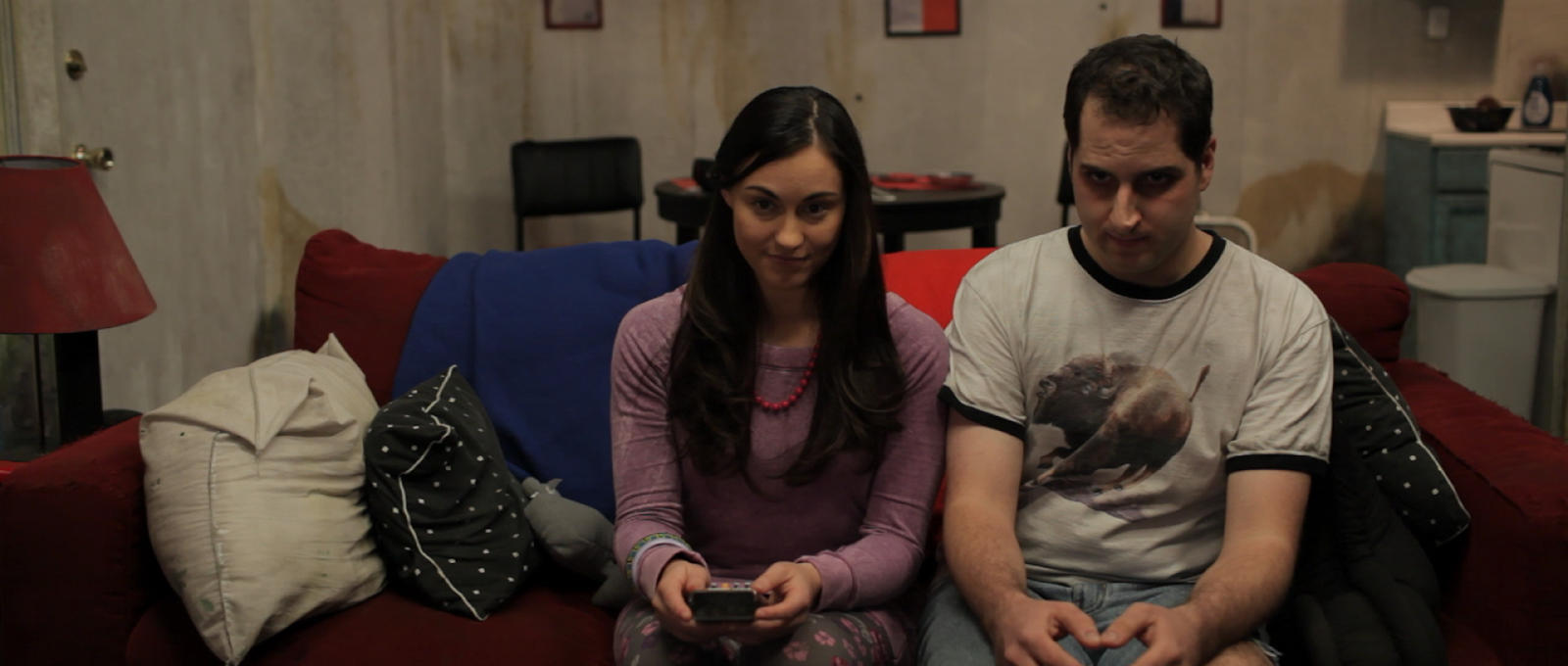 Leah and Ian getting cozy on the couch in Motivational Growth (2013)