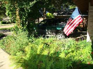 picture of American flag outside home in USA