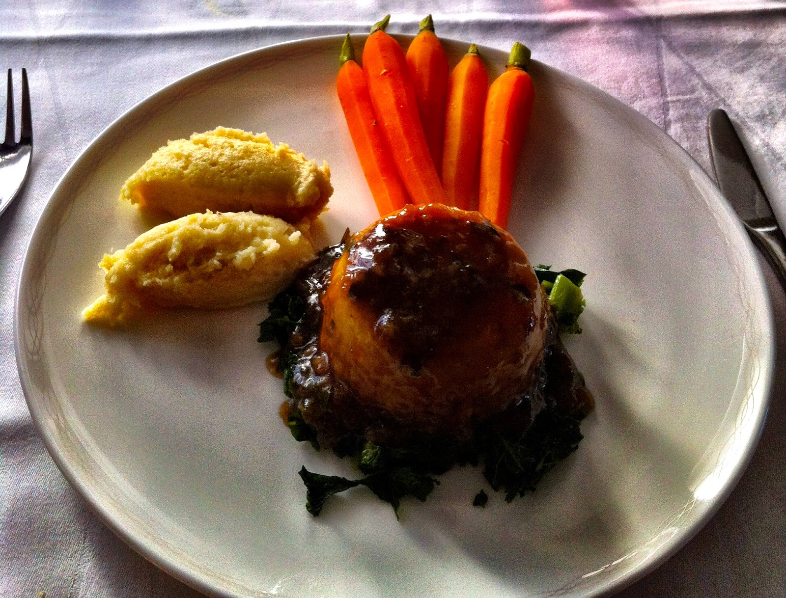 British beef and baby onion pudding - BA First Class