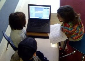 Students working with a computer