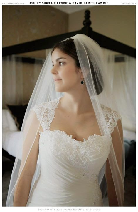 Ashley wore a full length veil on her wedding day