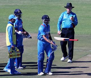 Virat-Kohli-tosses-his-bat-Zimbabwe-vs-India-2nd-ODI