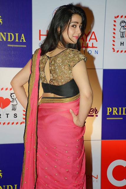 Charmi Kaur Latest Photos in Pink Saree