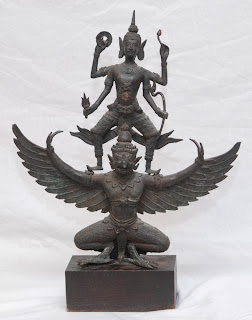 Garuda, Vishnu's mount and the eternal enemy of serpents; stone carving from South-East Asia.