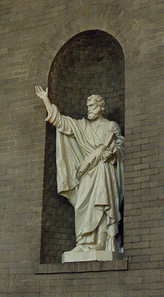 Statue of St Peter holding the keys of Heaven in his left hand and summoning the people with his right
