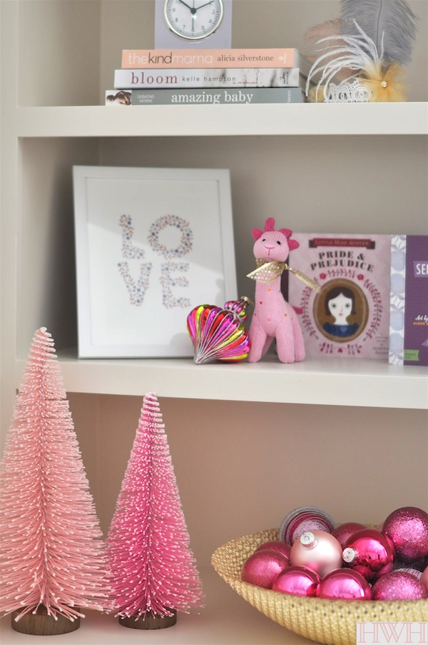 Festive holiday nursery with pink Christmas trees and ornaments in a bowl. | Honey We're Home