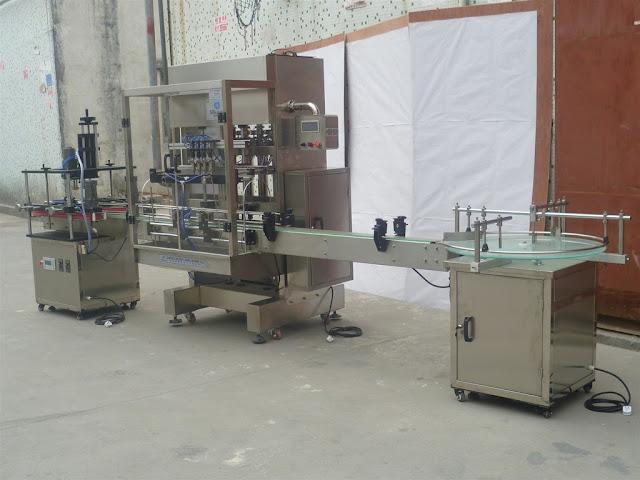 automatic bottle filling capping machine for shampoo Füll-Verschließmaschine für Flüssigkeiten