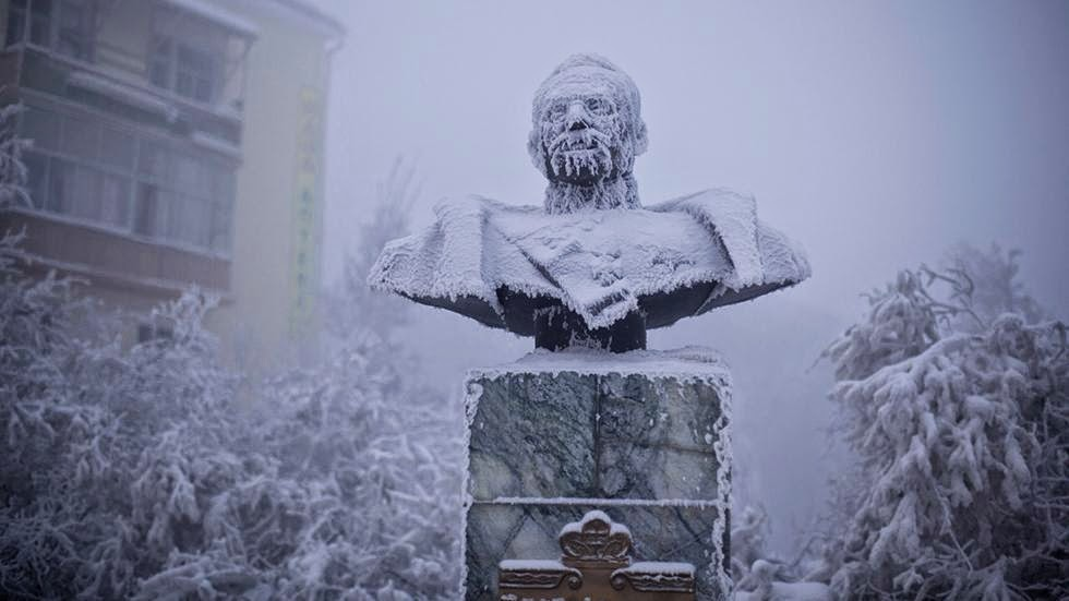 A statue of Ivan Kraft, one of the first governors of Yakutia, stands caked in frost most of the year. - Welcome to The Coldest Place Inhabited By Humans on Earth