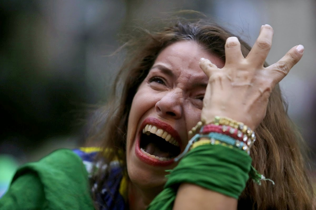 Crying Brazilian fun after Brazil lost semifinal world cup 2014