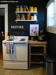 mylittlehousedesign.com rossio cork floors in the kitchen with black walls and white cabinets
