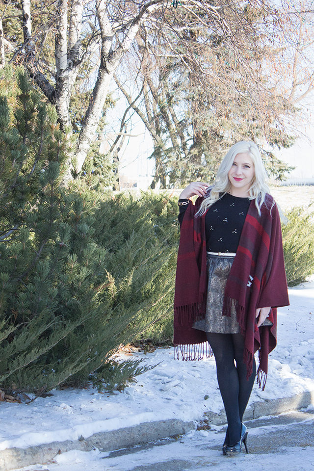 Burgundy Grey Cup shawl by CFL x eLUXE with embellished sweater and gold skirt.