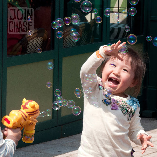 A little Korean girl playing with bubbles at Everland near Seoul, South Korea.