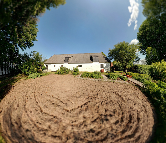 panoramic image of garden and farm