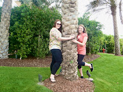 Hugging a palm tree on Palm Tree Island