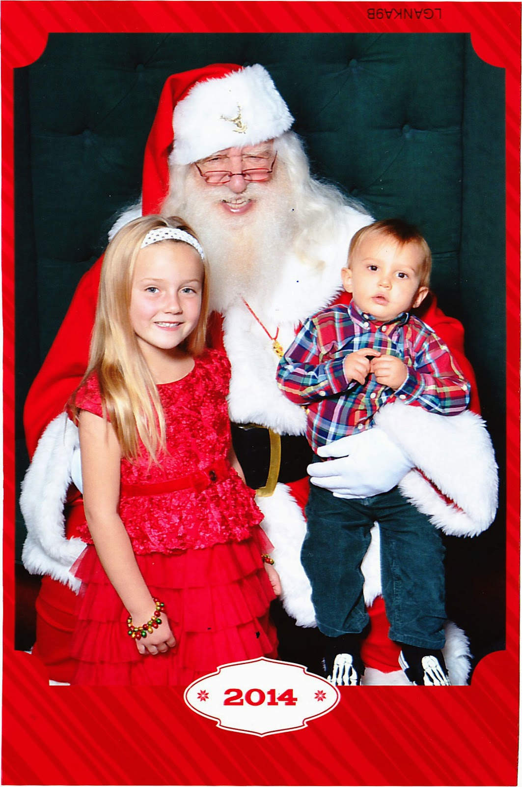 Cousin Belle and Reef Indy with the Mall Santa.