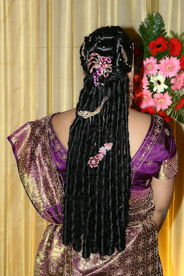 Bridal hairstyle with curls and ornaments.
