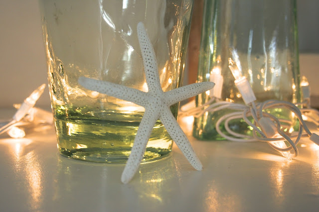 starfish and blue glass - Budget Living Room / Dining Room Makeover Reveal! - Nest of Bliss