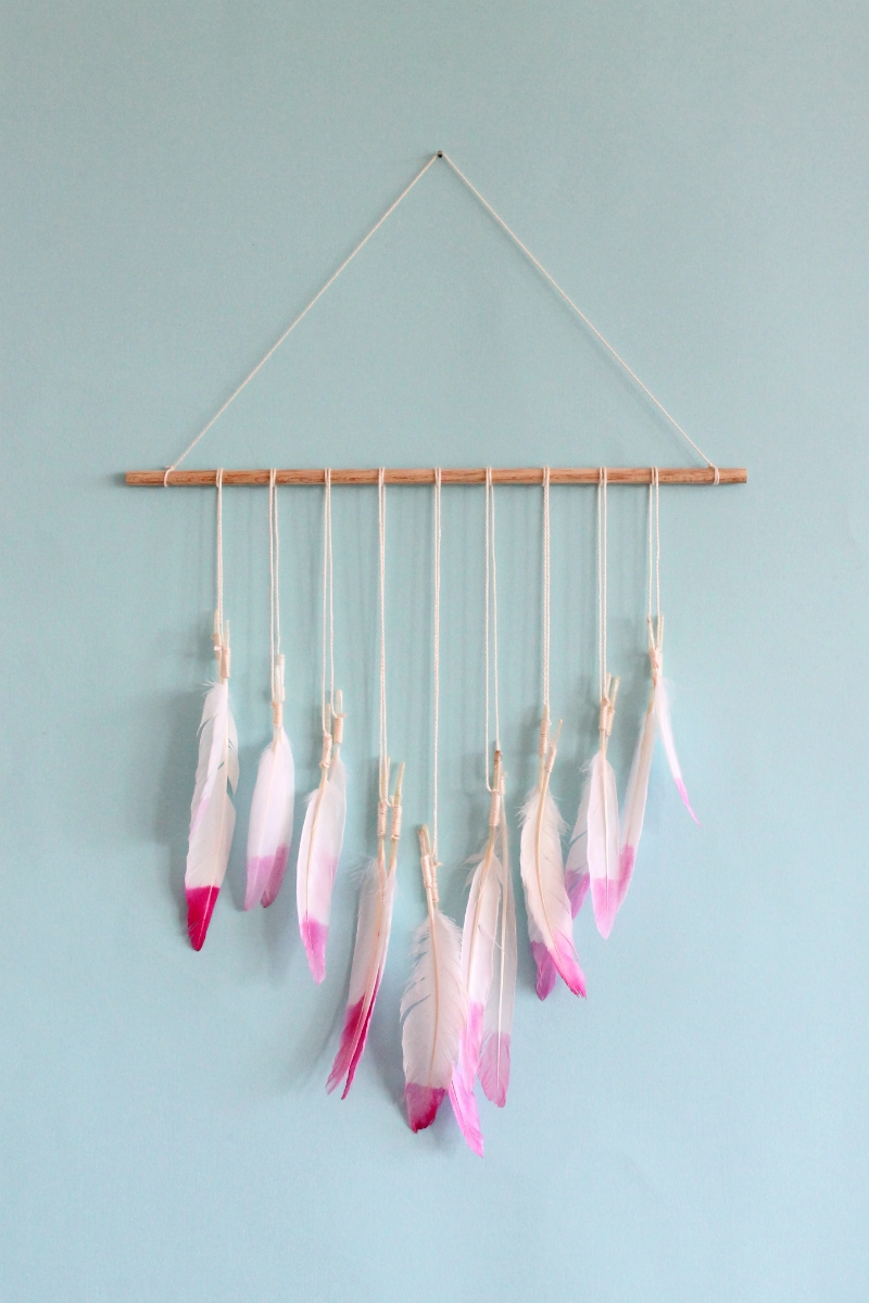 DIY dip dyed feather wall hanging