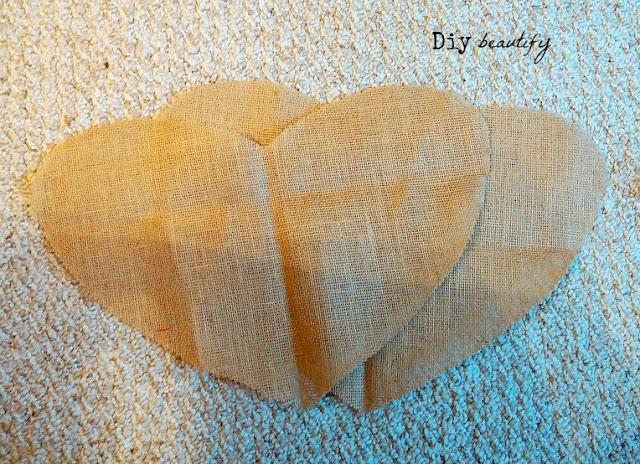 Looking for something unique to hang on your door this Valentines? Make this burlap heart! Step by step directions included at diy beautify!