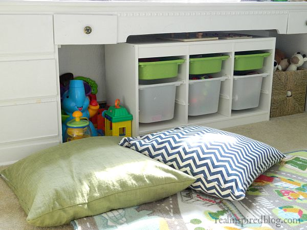 A boys' vintage modern nursery reveal! A simple makeover using a primary color palette to unify everything from toys to vintage heirlooms and sentimental objects. DIY floor pillows.