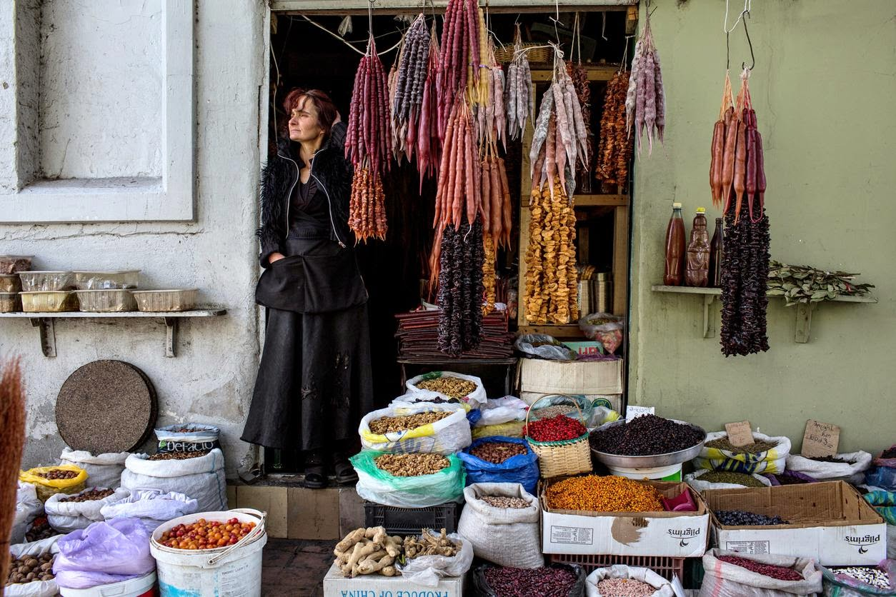 A shopowner sells dried fruits and nuts at the Dezertiri Market in Tbilisi, Georgia. Credit David Hagerman Da Nang is list - 52 Places to Go in 2015 by NYtimes  A wine revival at the foot of the Caucasus.
