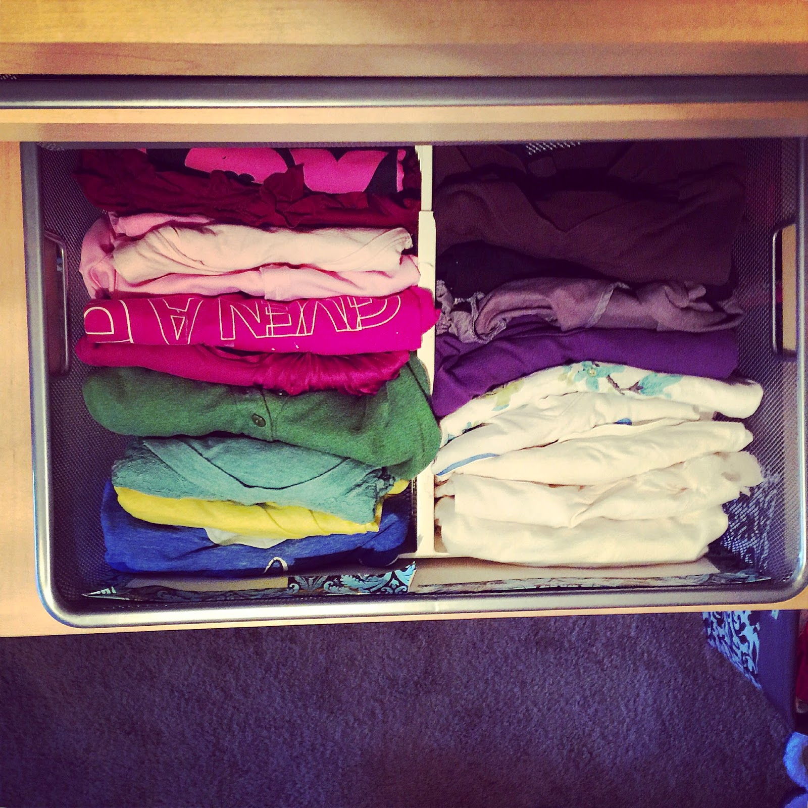 Fold shirts in quarters, then stack like a file in the drawer :: OrganizingMadeFun.com
