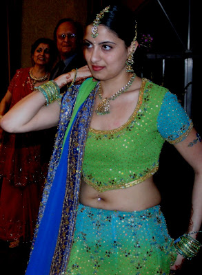 aunty in green dress showing folded waist