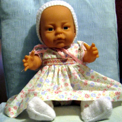 Newborn dressing doll baby