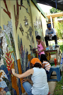 tamara and volunteers working on mosaic