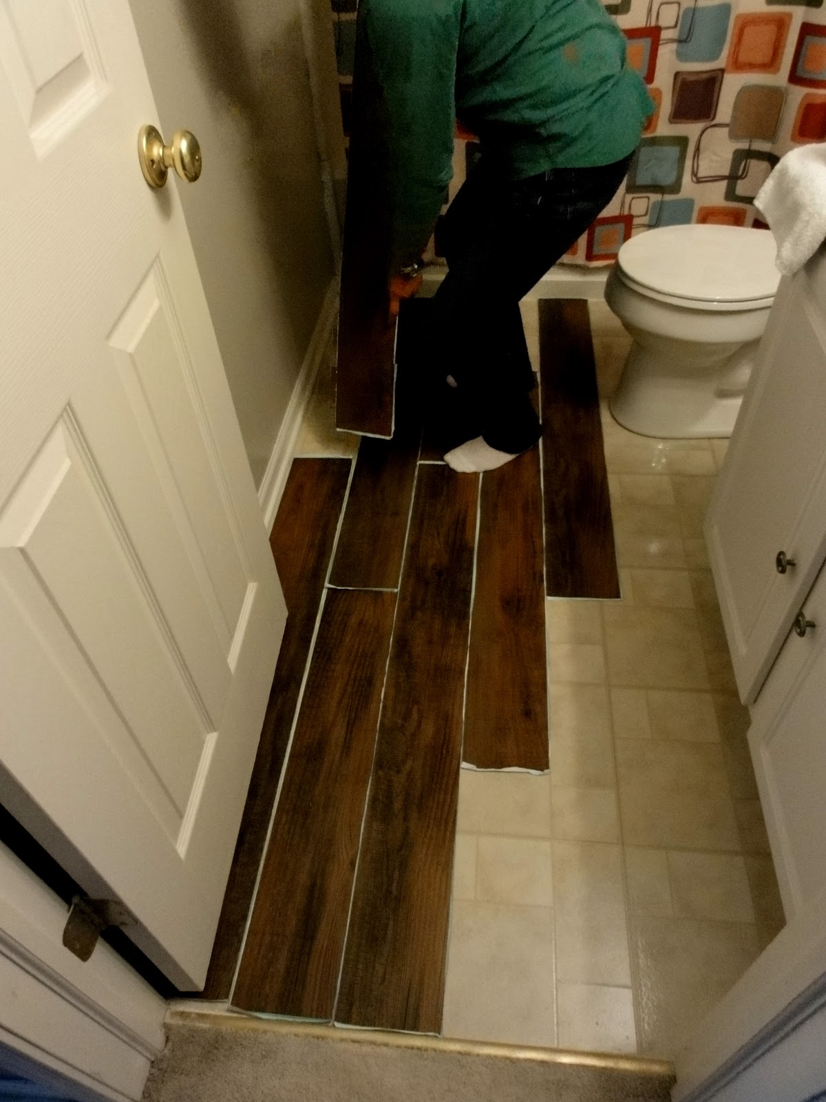 How to paint sinks and epoxy on pinterest for Paint vinyl floor bathroom