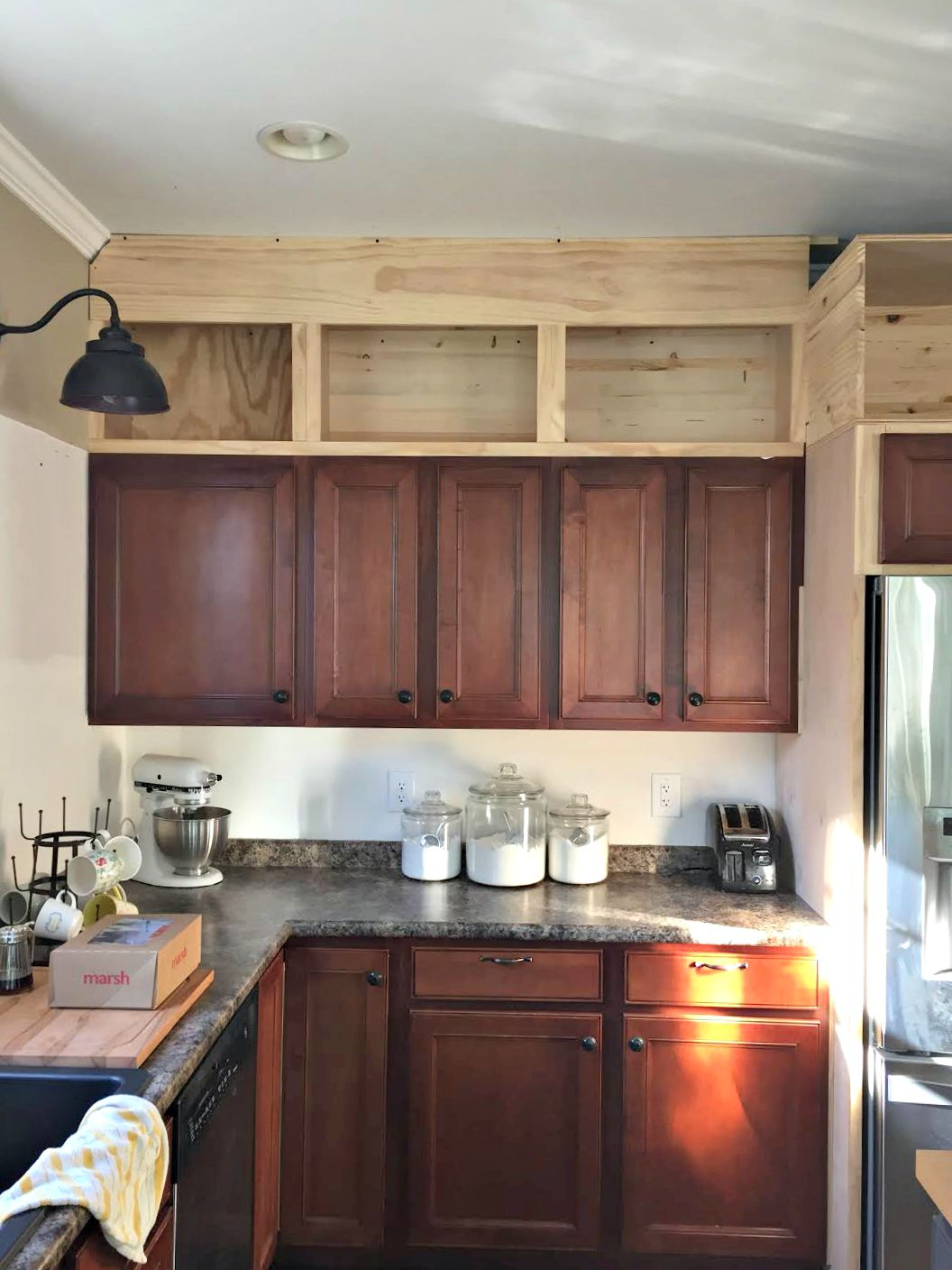 Building cabinets up to the ceiling from thrifty decor chick for Small upper kitchen cabinets