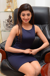 Pranitha looks so cute and Beautiful in Sleevelss Small Gown at Dynamite Interview