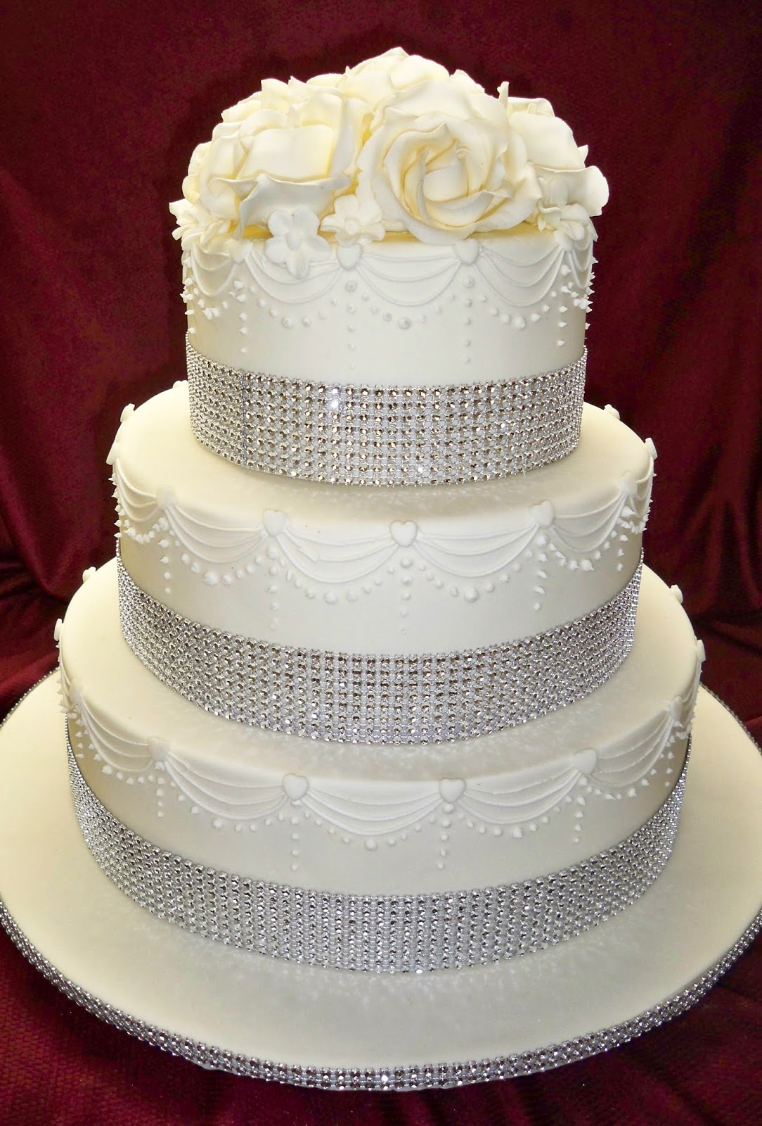 White roses and diamond ribbon white wedding cake | Elisabeth\'s ...