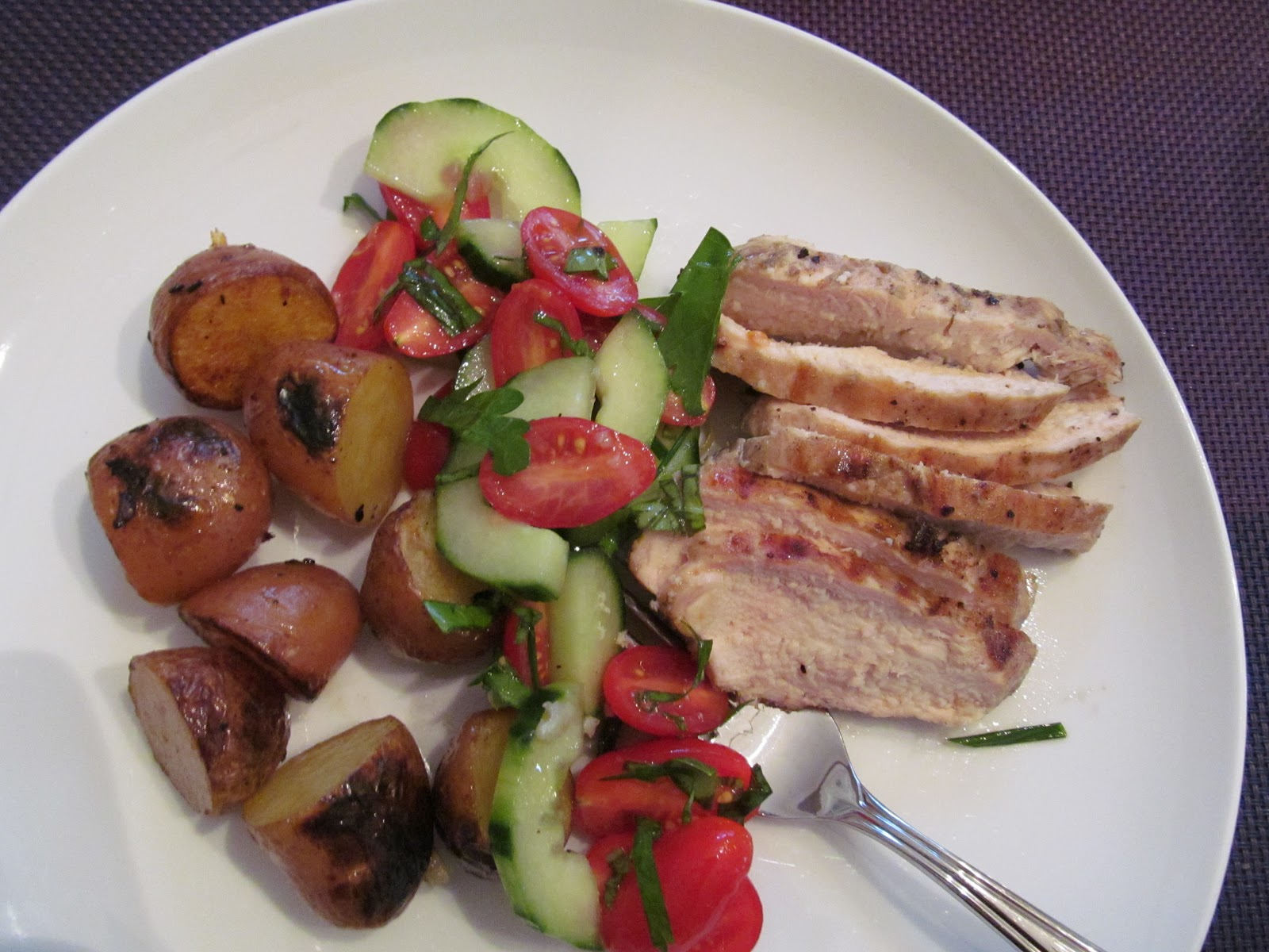 ... of dinner: Grilled Chicken and Potatoes with Tomato and Cucumber Salad