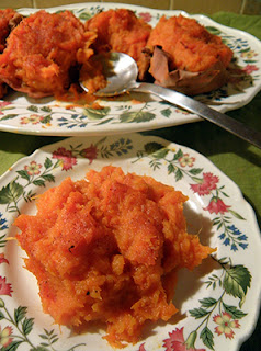 Single Serving of Yams with Platter of more in Background